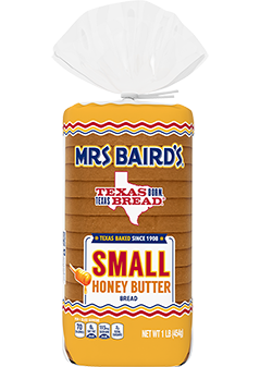 A bag containing a small loaf of Mrs Baird's Small Honey Butter Bread
