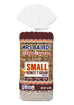 A bag containing a small loaf of Mrs Baird's Small Honey 7 Grain bread